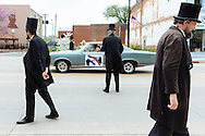 Abraham Lincoln impersonators participate in a parade during the Association of Lincoln Presenters' annual convention in Vandalia, Illinois. Reenactors representing both Lincoln and his wife, Mary Todd Lincoln, gathered in Vandalia in an annual event that celebrates the life of the 16th president.