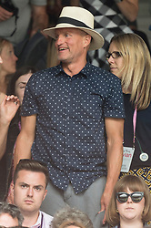 © Licensed to London News Pictures. 12/07/2019. London, UK.  Woody Harrelson watches centre court tennis on Day 11 of the Wimbledon Tennis Championships 2019 held at the All England Lawn Tennis and Croquet Club. Photo credit: Ray Tang/LNP