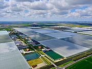 Nederland, Noord-Holland, Wieringermeer, 07-05-2021; Middenmeer, Agriport, Wagenpad -  zicht op de glastuinbouw kassen voor het verbouwen van  trostomaten en komkommers.<br /> Middenmeer, Agriport - view of the greenhouse horticulture greenhouses for growing vine tomatoes and cucumbers.<br /> <br /> luchtfoto (toeslag op standard tarieven);<br /> aerial photo (additional fee required)<br /> copyright © 2021 foto/photo Siebe Swart