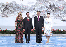 (170904) -- XIAMEN, Sept. 4, 2017 (Xinhua) -- Chinese President Xi Jinping and his wife Peng Liyuan welcome Mexican President Enrique Pena Nieto and his wife before a banquet for those attending the ninth BRICS summit and the Dialogue of Emerging Market and Developing Countries in Xiamen, southeast China's Fujian Province, Sept. 4, 2017.  (Xinhua/Ma Zhancheng)  (zhs) (Photo by Xinhua/Sipa USA)