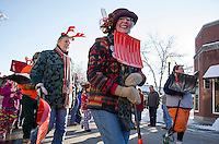 """Dorothy Duffy is one """"happy shoveler"""" marching with the Snow Shovelers Brigade down Main Street during the Holiday Parade on Saturday afternoon.  (Karen Bobotas/for the Laconia Daily Sun)"""