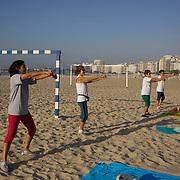 An early morning fitness class on Copacabana beach, Rio de Janeiro,  Brazil. 9th July 2010. Photo Tim Clayton..