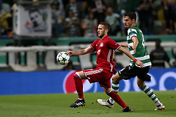 November 22, 2017 - Lisbon, Portugal - Olympiacos' Greek midfielder Kostas Fortounis (L ) fights for the ball with Sporting's defender Andre Pinto from Portugal during the UEFA Champions League group D football match Sporting CP vs Olympiacos FC at Alvalade stadium in Lisbon, Portugal on November 22, 2017. Photo: Pedro Fiuza  (Credit Image: © Pedro Fiuza/NurPhoto via ZUMA Press)