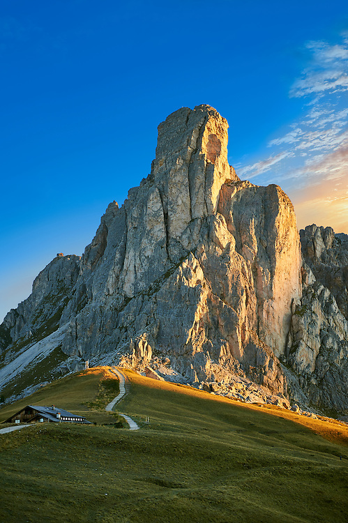 Nuvolau at sunset mountain above the Giau Pass (Passo di Giau), Colle Santa Lucia, Dolomites, Belluno, Italy .<br /> <br /> Visit our ITALY HISTORIC PLACES PHOTO COLLECTION for more   photos of Italy to download or buy as prints https://funkystock.photoshelter.com/gallery-collection/2b-Pictures-Images-of-Italy-Photos-of-Italian-Historic-Landmark-Sites/C0000qxA2zGFjd_k
