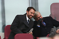 Gareth Southgate, the England manager talking to Trevor Brooking in the stands. Premier league match, West Ham Utd v West Bromwich Albion at the London Stadium, Queen Elizabeth Olympic Park in London on Saturday 11th February 2017.<br /> pic by John Patrick Fletcher, Andrew Orchard sports photography.