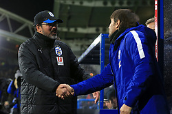12th December 2017 - Premier League - Huddersfield Town v Chelsea - Huddersfield manager David Wagner (L) shakes hands with Chelsea manager Antonio Conte before the match - Photo: Simon Stacpoole / Offside.