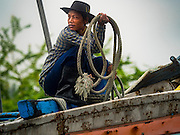 01 OCTOBER 2015 - MAHACHAI, SAMUT SAKHON, THAILAND:  A member of a fishing crew on the prow of a Thai fishing trawler in Mahachai, one of Thailand's largest fishing ports. Thailand's fishing industry had been facing an October deadline from the European Union to address issues related to overfishing and labor practices. Failure to adequately address the issues could have resulted in a ban on Thai exports to the EU. In September Thai officials announced that they had secured an extension of the deadline. Officials did not say how much extra time they had to meet the EU goals. Thailand's overall annual exports to the EU are between 23.2 billion Thai Baht and 30 billion Thai Baht (US$645 million to US $841 million). Thailand's total fish exports were worth about 110 billion baht in 2014.   PHOTO BY JACK KURTZ
