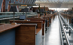 © London News Pictures. 2010.12.20. The longest champagne bar normally bustling with travellers, today empty while thousands queue below. St Pancras International EuroStar, thousands of travellers queue for hours in the bitter cold with the hope of getting on a train in the Christmas getaway, 20/10/2010. ..Eurostar closed their St Pancras office, no booking being taken until 24/12/2010. Staff advise passengers not to turn up to the station without a ticket for a confirmed running train. Picture caption should read Simon Lamrock/LNP