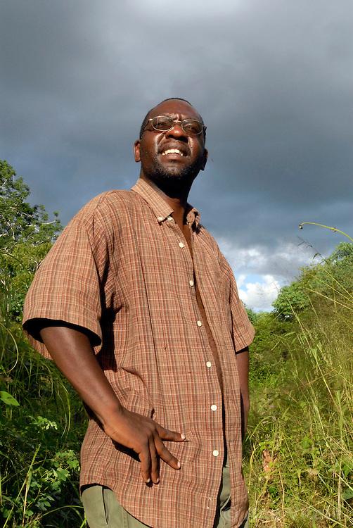Lion researcher Dennis Ikanda talks to villagers in a village near Simana,  outside of Lindi, Tanzania.
