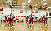 Laconia High School Cheerleaders lift Gabi Mooney, Katie Gorman and Gillian Gorse during their performance for the home crowd during the boys varsity basketball game Tuesday evening.  (Karen Bobotas/for the Laconia Daily Sun)
