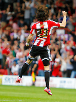 Brentford FC's Jota celebrates scoring the first goal during the Sky Bet Championship game against Leeds United at Griffin Park