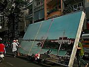 Vietnam, Ho Chi Min City: transporting a view of the ancient saigon. trasporto di una  riproduzione della vecchia Saigon.