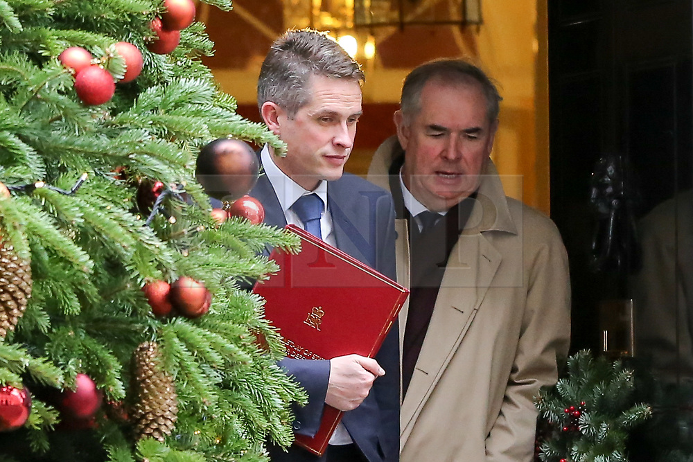 """© Licensed to London News Pictures. 18/12/2018. London, UK. Gavin Williamson - Secretary of State for Defence (L) and Geoffrey Cox - Attorney General (R) departs from No 10 Downing Street after attending the weekly Cabinet Meeting that discussed the preparations for a """"No Deal"""" Brexit. Photo credit: Dinendra Haria/LNP"""