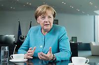 23 AUG 2017, BERLIN/GERMANY:<br /> Angela Merkel, CDU, Bundeskanzlerin, waehrend einem Interview, in Ihrem Buero, Bundeskanzleramt<br /> IMAGE: 20170823-02-011<br /> KEYWORDS: Büro