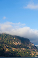 The view of the Columbia RIver Gorge from Highway 14 in Washington State with morning mist clinging to the side of the mountains.