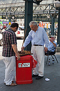 Men playing chess in the Jungfernstieg Central station square, Hamburg, Germany.
