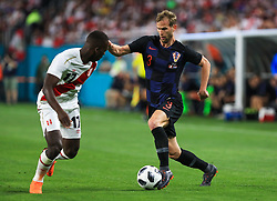 March 23, 2018 - Miami Gardens, Florida, USA - Croatia defender Ivan Strinic (3) drives the ball challenged by Peru defender Luis Advincula (17) during a FIFA World Cup 2018 preparation match between the Peru National Soccer Team and the Croatia National Soccer Team at the Hard Rock Stadium in Miami Gardens, Florida. (Credit Image: © Mario Houben via ZUMA Wire)