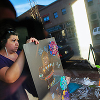 010914  Adron Gardner/Independent<br /> <br /> Alicia Esparza prepares pieces of her art for display at the Industry Gallery in Gallup Friday.