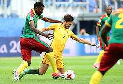2017?6?23?.   ????????——?????????????????.    6?22???????????????????????????????????.    ??????????????2017????????B???????????1?1?????????.    ?????????..(SP)RUSSIA-ST. PETERSBURG-2017 FIFA CONFEDERATIONS CUP-CMR VS AUS..(170623) -- ST. PETERSBURG, June 23, 2017  Andre Zambo (1st L) of Cameroon vies with Mathew Leckie (2nd L) of Australia during the group B match between Cameroon and Australia of the 2017 FIFA Confederations Cup in St. Petersburg, Russia, on June 22, 2017. The match ended with a 1-1 tie.  7 9854294892 (Credit Image: © Xu Zijian/Xinhua via ZUMA Wire)