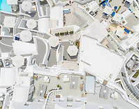 Aerial view above traditional white houses on Santorini island, Greece.