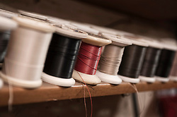 Variety of yarn bobbins in a cobbler's shop