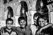 Four Syrian boys enjoy a sunny afternoon inside the Umayyad Mosque in the old city of Damascus. The expansive courtyard of the mosque is a popular place for family and friends to relax and enjoy fellowship.