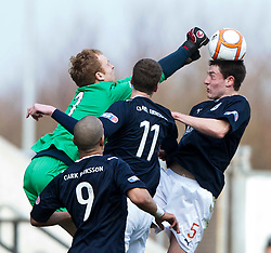 Queen of the South's keeper Lee Robinson and Murray Wallace (5)..Falkirk 3 v 0 Queen of the South, 25/2/2012..© Michael Schofield.