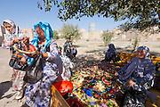 Uzbekistan, Khiva. Uzbek pilgrims having a picknick.