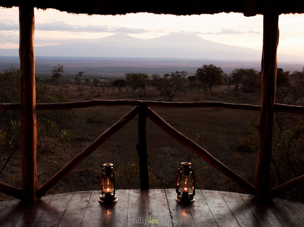 View of Mount Kilimanjaro from Hut accomodation at an Eco Tourist Campsite. Chyulu Hills region, Kenya