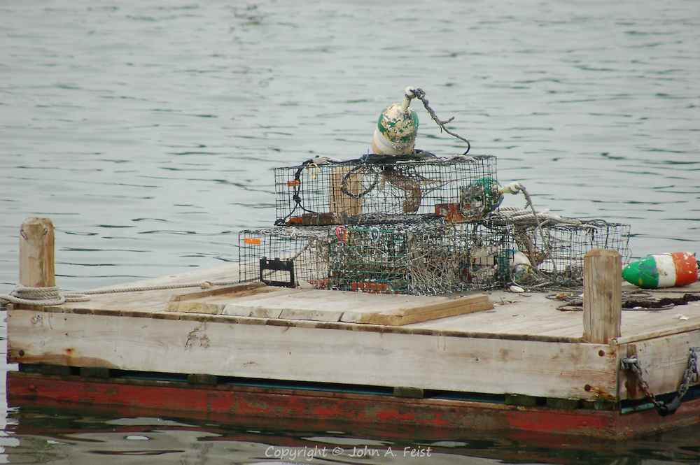 A collection of traps and buoys in the waters of Long Island Sound off Stone Creek, CT