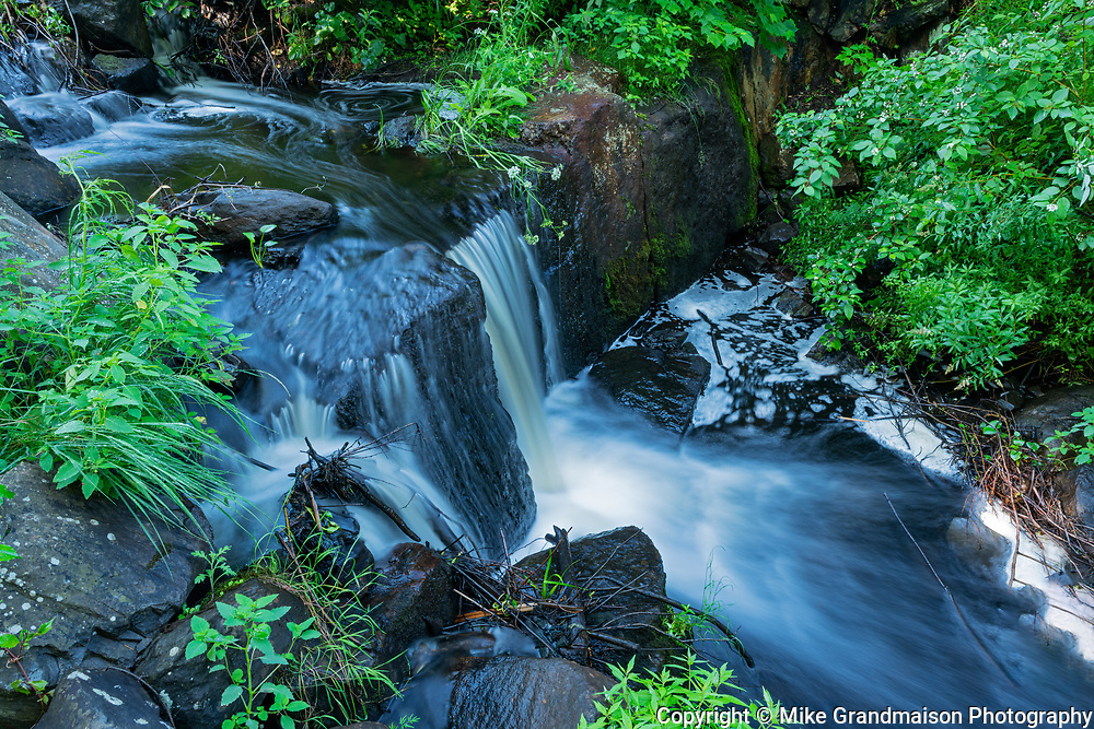 Small waterfall off a hiking trail near Star Lake<br />Whiteshell Provincial Park<br />Manitoba<br />Canada