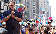 Rev. Jesse Jackson addresses protesters gathered to march in protest of President Bush and his administration's agenda, Saturday, August 28, 2004