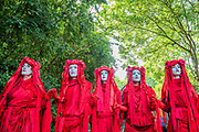 People representing the blood of extinct animals and those soon to be - The Extinction Rebellion protest march around the site, led by their Iconic pink boat, Tell the Truth - The 2019 Glastonbury Festival, Worthy Farm. Glastonbury, 27 June 2019