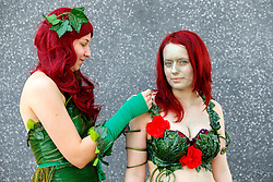 © Licensed to London News Pictures. 25/10/2015. London, UK. Cosplayers dressed as Poison Ivy attending the MCM London Comic Con at ExCeL Convention Centre on Sunday, 25 October 2015. Photo credit: Tolga Akmen/LNP