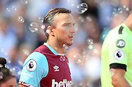 Mark Noble, West Ham United captain looks on as he walks out from the tunnel onto pitch. Premier league match, West Ham Utd v AFC Bournemouth at the London Stadium, Queen Elizabeth Olympic Park in London on Sunday 21st August 2016.<br /> pic by John Patrick Fletcher, Andrew Orchard sports photography.