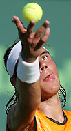 4/01/05 Rafael Nadal serves up the ball on his way to defeat David Ferrer 4-6, 3-6 during the Nasdaq-100 at Key Biscayne, Florida.