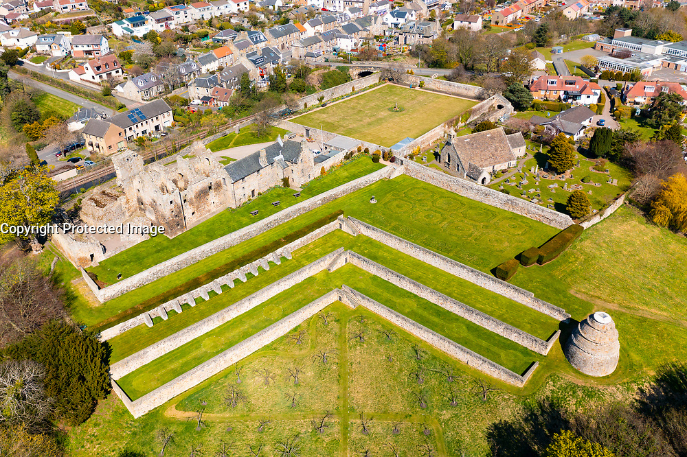 Aerial view from drone of Aberdour Castle (closed during lockdown)  and grounds, Aberdour, Fife, Scotland, UK