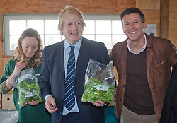 """© Licensed to London News Pictures. 23/02/2012. Wallington, Surrey. L-R: Anna Francis, Farm Manager, Boris Johnson and Seb Coe. The Mayor of London, Boris Johnson and LOCOG Chairman Sebastian Coe today, 23 February 2012, showed off the benefits of urban food growing as they launched """"The Big Dig"""" volunteer gardening weekend (16-17 March). This is all in support of Capital Growth, a scheme to create 2,012 community food growing spaces by the end of 2012.  Photo credit: Bettina Strenske/LNP"""