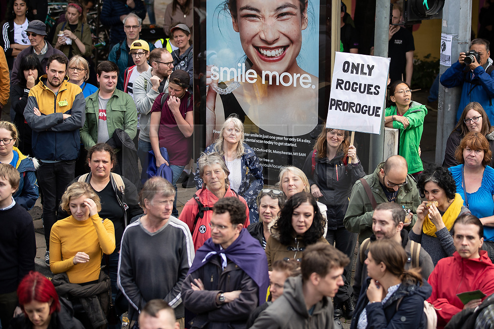 """© Licensed to London News Pictures. 31/08/2019. Manchester, UK. Placard reading """" Only Rogues Prorogue """" .Thousands attend a pro EU demo in Manchester City Centre and march en masse along John Dalton Street to join an Extinction Rebellion occupation of Deansgate . Objections are being raised about the Prime Minister Boris Johnson's intention to prorogue Parliament in the run up to Britain's planned Brexit deadline . Photo credit: Joel Goodman/LNP"""