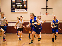 Lauryn Nash-Boucher dribbles the ball downcourt during the Senior Girls game between Gilford and Belmont during the 23rd annual Francoeur Babcock Basketball Tournament Saturday evening.  (Karen Bobotas/for the Laconia Daily Sun)