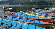 Colorful blue boats on Phewa Lake (or Fewa Tal), in Pokhara, Nepal.