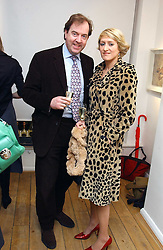 MARK CORNELL and ISABELLA MACPHERSON at an exhibition of artist Jonathan Yeo's portrait paintings held at Eleven, 11 Eccleston Street, London SW1 on 16th February 2006.<br /><br />NON EXCLUSIVE - WORLD RIGHTS