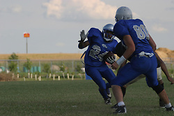 14 August 2004  Ray Bausley takes a stutter step while his team mate Scott Winter clears a path.    Twin City Storm V Capitol City Outlaws, Midwest Football League, Interstate Center, Bloomington-Normal IL
