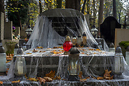 A gravestone covered with plastic to keep the gravestone free from fallen leaves at Rakowicki cemetery in Krakow, Poland 2019.