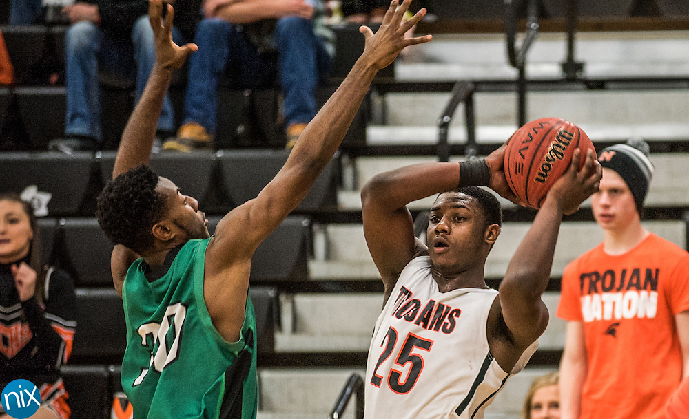 Northwest Cabarrus' Anthony Caldwell (25) looks to pass the ball against A.L. Brown Wednesday night at Northwest Cabarrus High School. The Trojans won the game 65-49.