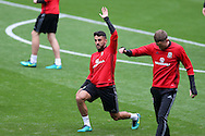 Neil Taylor of Wales warms up during Wales football team training at the Cardiff city Stadium in Cardiff , South Wales on Saturday 8th October 2016, the team are preparing for their FIFA World Cup qualifier home to Georgia tomorrow. pic by Andrew Orchard, Andrew Orchard sports photography