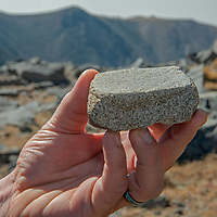 An archaeology team investigates artifacts at 12,400' in California's White Mountains, the highest Native American settlement in the United States.  This is the pestle for a grinding stone.