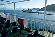 Smoke coming from the funnel of Ionian Lines ferry in Sami, Kefalonia, Greece. Kefalonia is an island in the Ionian Sea, west of mainland Greece.