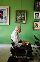 An elderly gentleman sits in on a free art class and a snack in Fort Pierce, Florida.