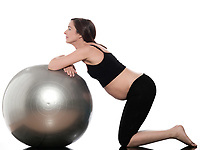 pregnant caucasian woman ball exercise isolated studio on white background